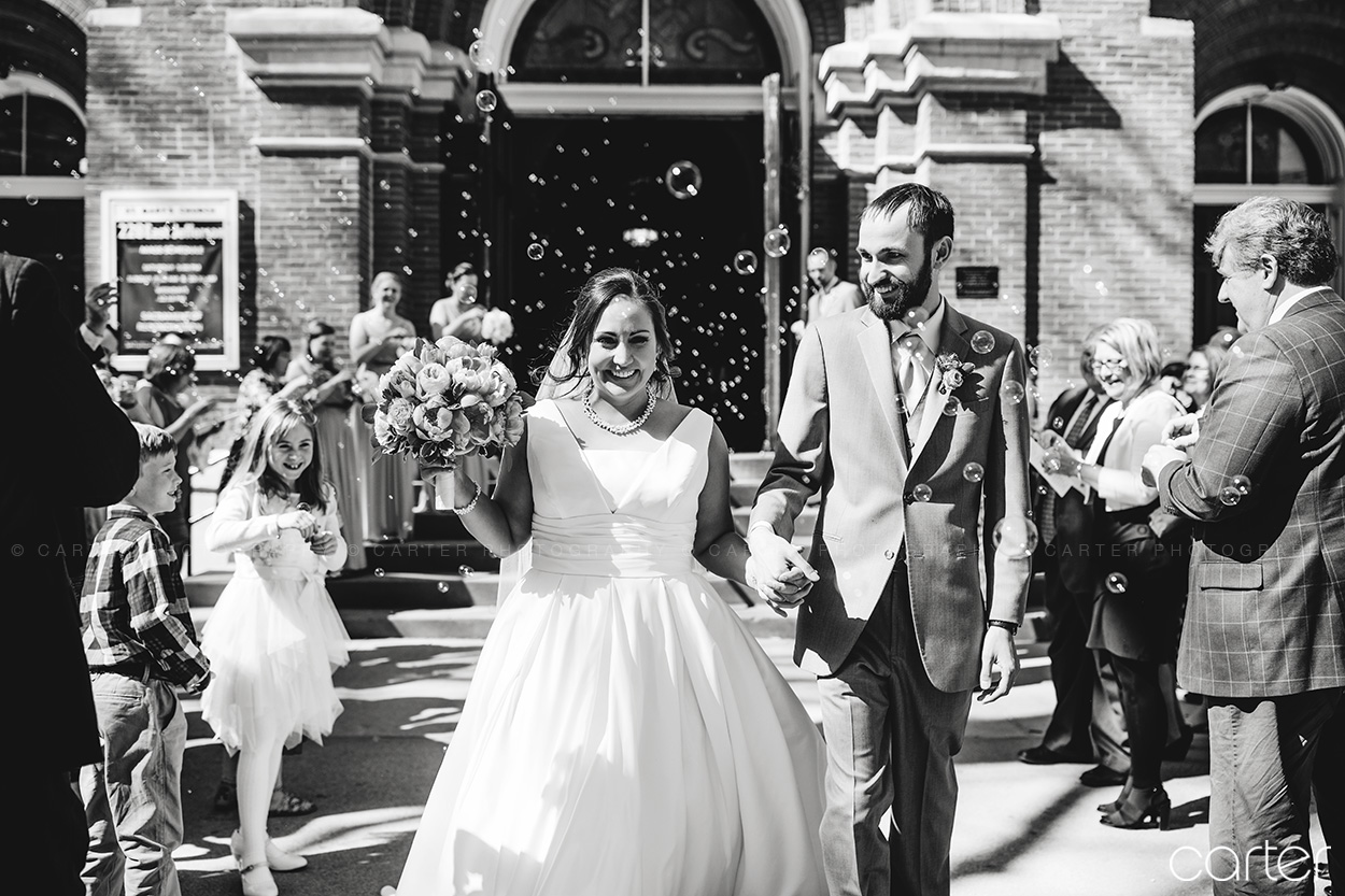 Bride Groom Wedding Bubble Exit St Mary's Church Iowa City - Carter Photography