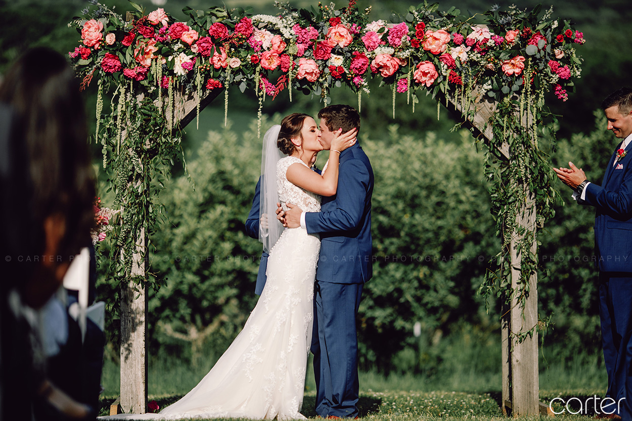 Weston Red Barn Farm Wedding Ceremony First Kiss Kansas City Suits Carter Photography